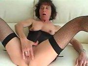 Slutty mature mistress sucks a hard dick and masturbates